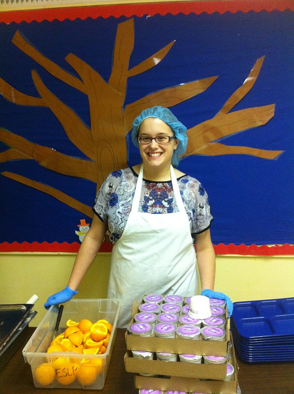 Flaman's Erin Mitchell Volunteers at E4C School Lunch Program